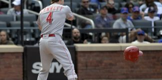 Argument pauses for 'God Bless America,' Reds beat Mets 10-5