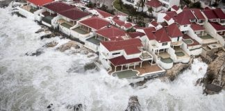 The Latest: Dutch airline KLM cancels flights to St. Maarten