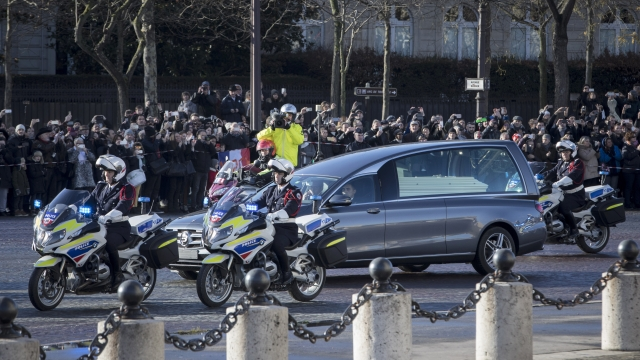 The Latest: Fans weep for Hallyday, France's king of rock