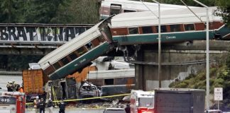 The Latest: NTSB: Derailed train going 80 mph in 30 mph zone
