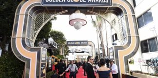 The Latest:  Bathrooms at Golden Globes are like hair salons