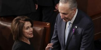 The Latest: Democrats make fashion _ and button _ statements