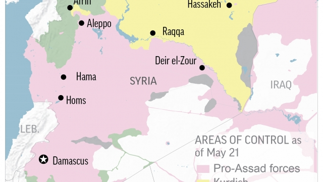 Airstrikes on pro-government positions in east Syria kill 12