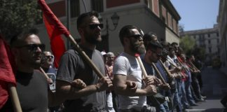 Greek workers join general strike as end of bailout looms