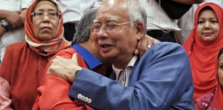Mahathir bars predecessor from leaving Malaysia amid probe