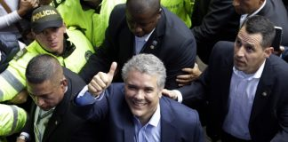 The Latest: Early results show Duque leading Colombian vote