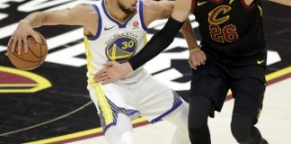 The Latest: Curry on point, Warriors lead Cavs at halftime