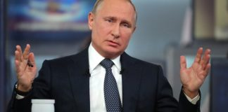 The Latest: Putin pledges to respect internet freedoms