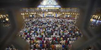 The Latest: Syria's Assad attends Eid prayers on coast