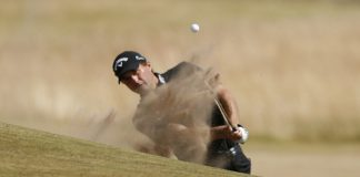 Kisner shoots 66 to take early lead in British Open