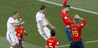 The Latest: Dzyuba penalty equalizes for Russia vs Spain
