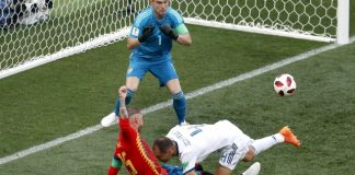 The Latest: Russian own goal gives Spain 1-0 lead in 12th