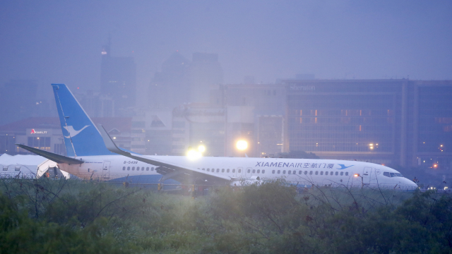 Chinese plane skids off Manila runway in downpour, all safe