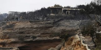 Greek island wildfire that forced villages to evacuate eases