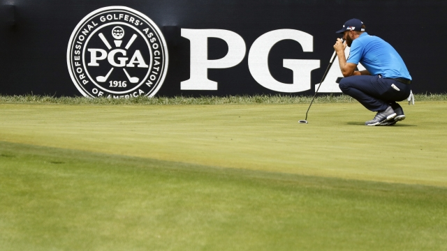 The Latest: Leaders off in PGA Championship's final round