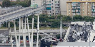 The Latest: Official says bridge collapse death toll is 20